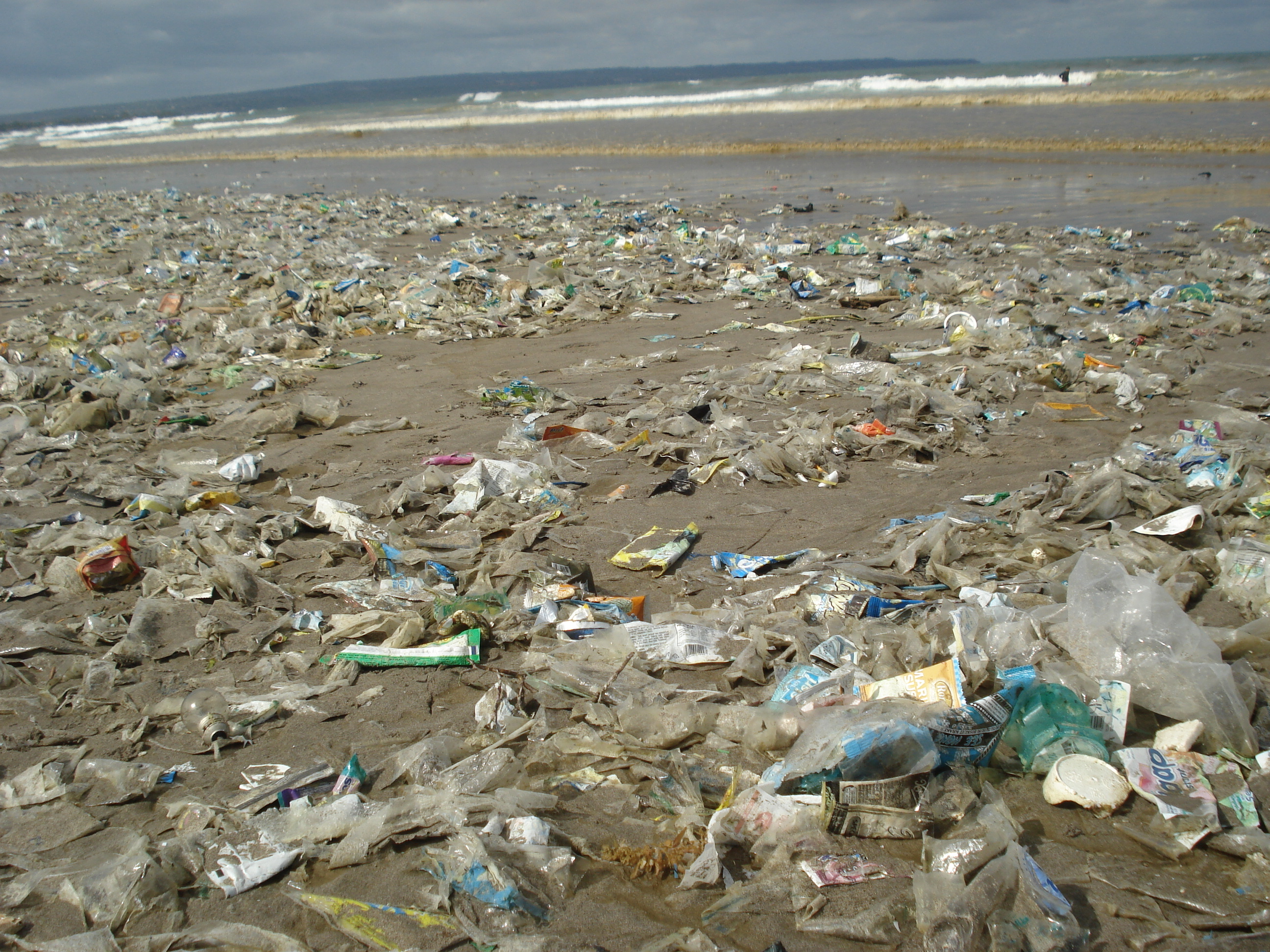 beach with a lot of plastic waste coming from the sea
