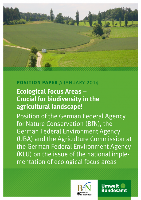 """Cover of the position paper """"Ecological Focus Areas – Crucial for biodiversity in the agricultural landscape!"""" with a photo of a landscape with fields, trees, bushes and forest"""