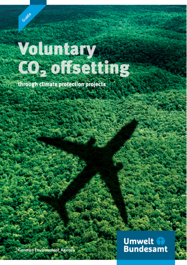 """Cover of the brochure """"Voluntary CO2 offsetting through climate protection projects"""" with a photo of a plane flying above a forest"""