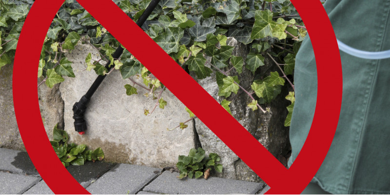 Bild mit Spritze auf Bürgersteig und einem roten Verbotszeichen darüber
