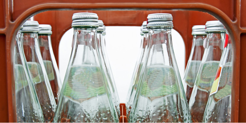 returnable glass bottles with mineral water in a crate