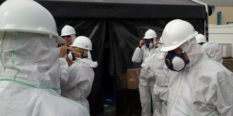 Wearing personal protective equipment during remediation