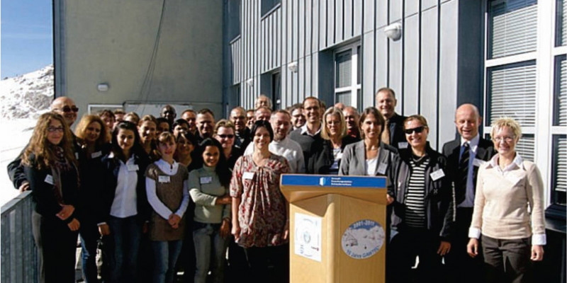 Global Atmosphere Watch Training & Education Centre (GAWTEC) celebrates 10th anniversary: a group of persons standing in front of a house