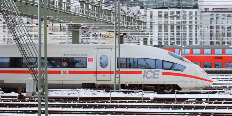 modern high speed train in the city in winter