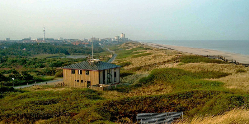 Small, two-storey wooden building in the dunes