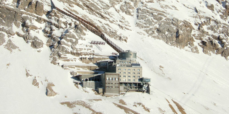Building of the air quality measuring station on a snow-covered slope
