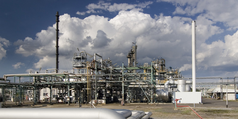 Close-shot of a chemical facility in front of a cloudy sky