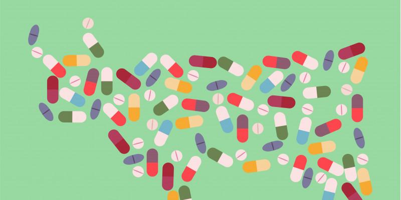 Bunte, illustrierte Pillen und Kapseln bilden die Umrisse einer Kuh vor einem mattgrünem Hintergrund