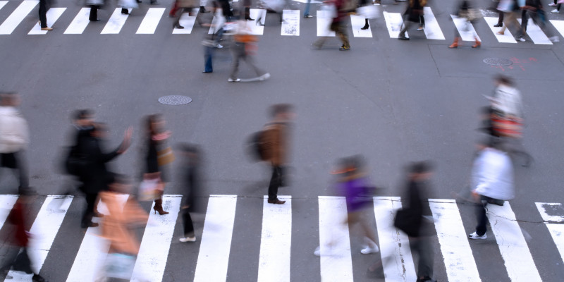 pedestrians are crossing a street on an cross-walk