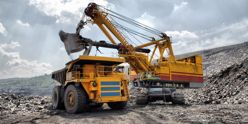 Truck and excavator for the degradation abiotic raw materials