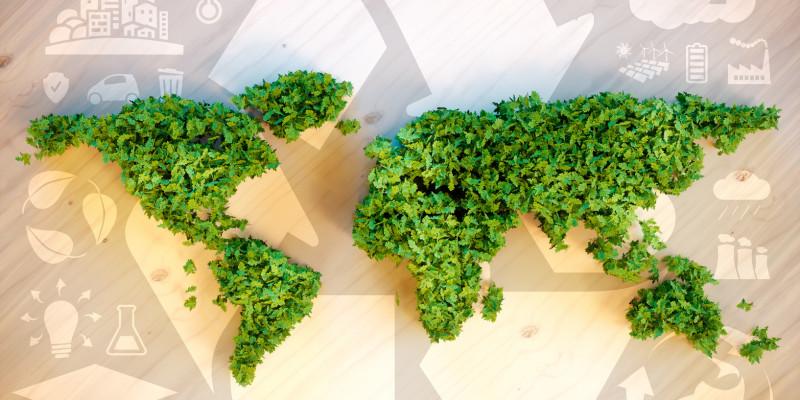 Eine Grafik mit einer grünen Weltkarte