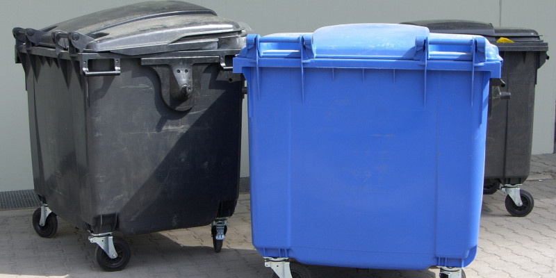 Three large garbage containers for waste paper and waste