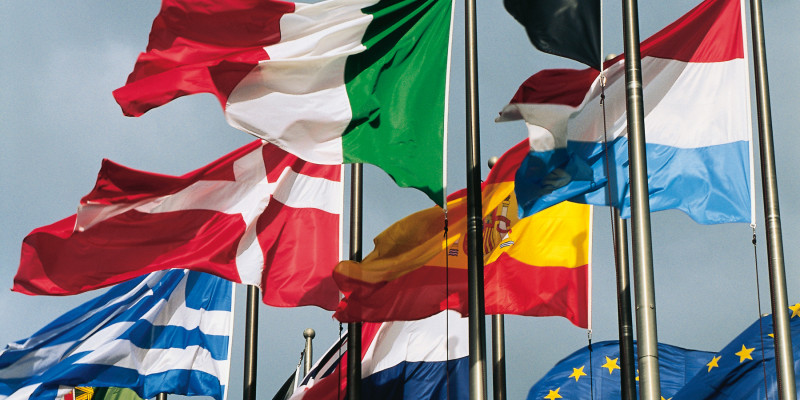 Waving flags of Switzerland, Greece, Spain, Luxembourg, Italy, the Netherlands, Portugal, the United Kingdom, Belgium and the European Union