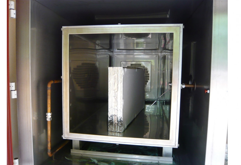 A gypsum board in an emissions testing chamber.