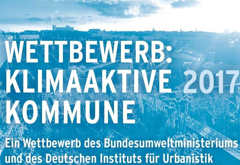 """Das Logo des Wettbewerb zeigt den Titel """"Klimaaktive Kommunen 2017"""" und die Ausrichter Bundesumweltministerium und Deutsche Institut für Urbanistik"""