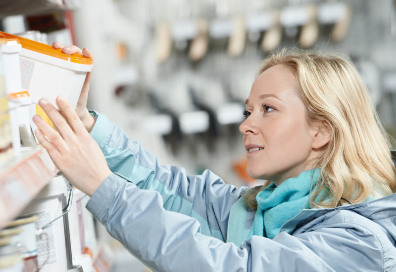 woman shopping in a building supplies store