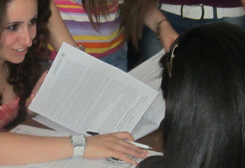 young women look in a document