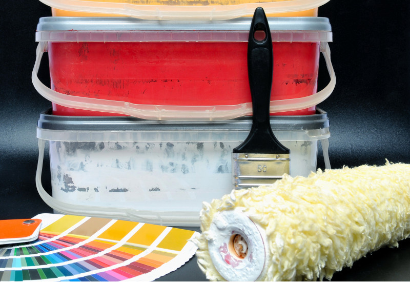 paint buckets, paint brush and paint roller