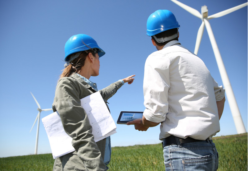 two engineers (a women and a man) in a windfarm