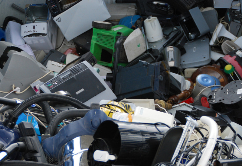 used electrical and electronic equipment in a container, for example monitors, computers and household appliances