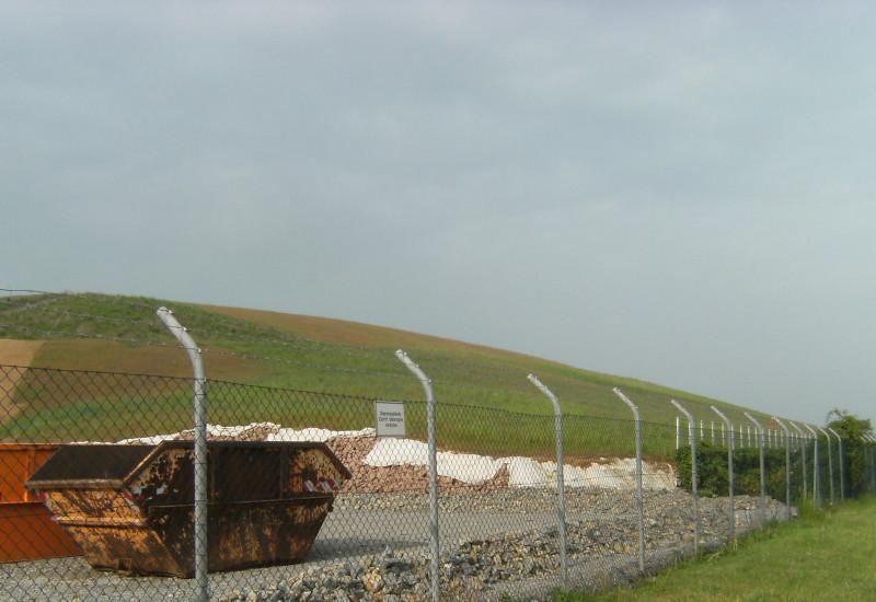 Leafy landfill, fenced