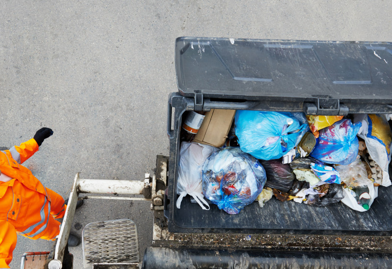 A waste container being emptied