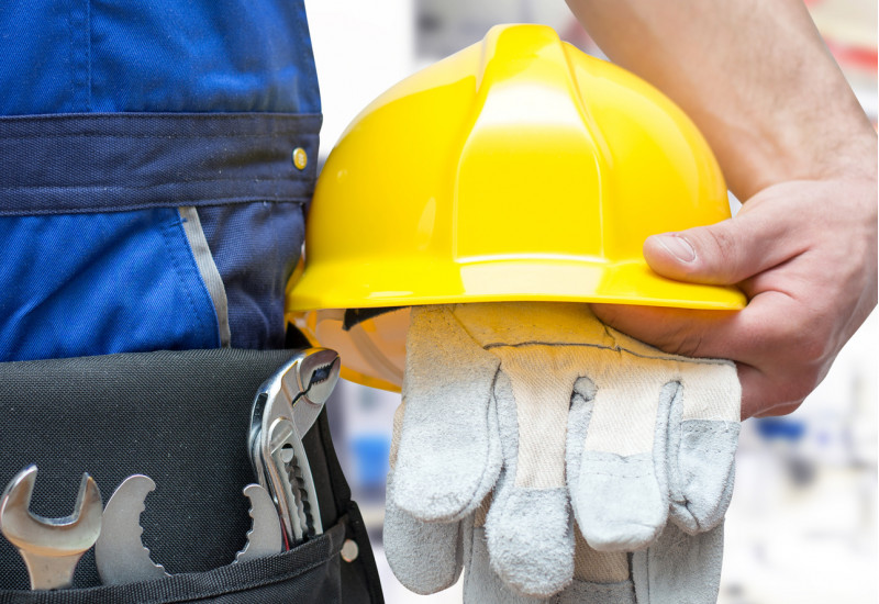 worker with tools and crash helmet