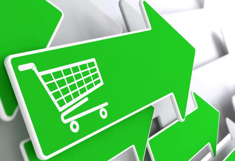 mehrere grüne Pfeile, die in eine Richtung weisen, einer davon mit der Abbildung eines Einkaufswagens