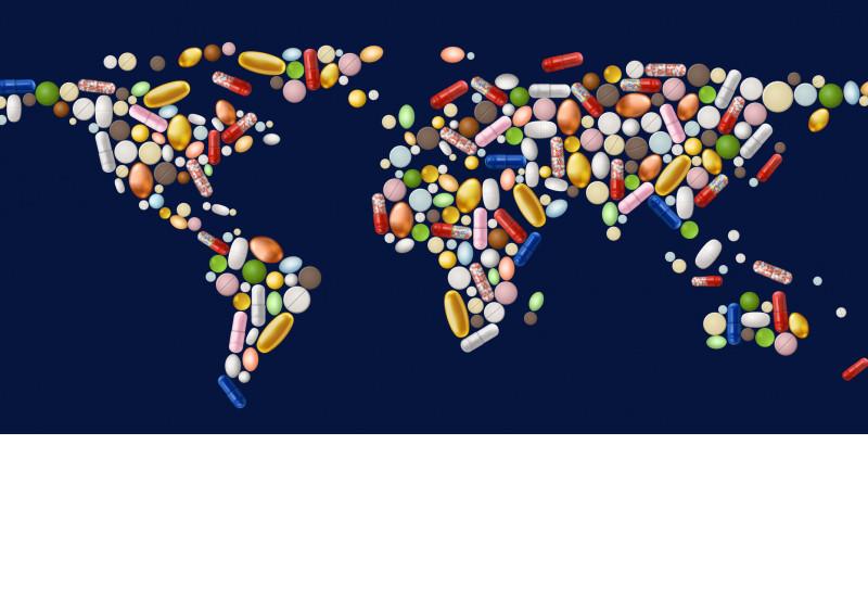 Eine Weltkarte mit Pillen.