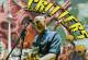 Collage, Mann mit Gitarre vor der Berliner Skyline, dazu gezeichnete Figuren