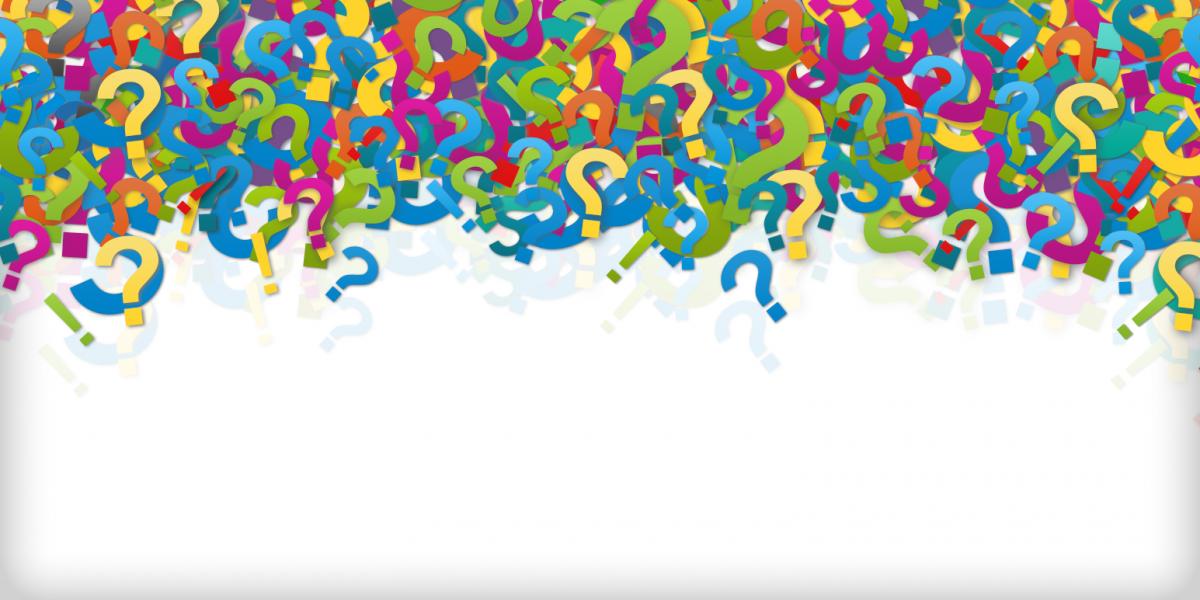 Symbolbild: Viele ausgeschnittene bunte Fragezeichen liegen auf einem Haufen